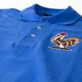 Détail du col et du logo du Coq du maillot  de foot des bleus, équipe de France des années 50.